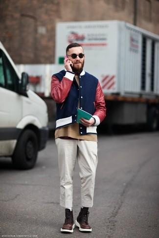 How to wear: white chinos, burgundy crew-neck t-shirt, tan crew-neck sweater, navy varsity jacket