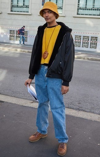 How to Wear a Mustard Crew-neck Sweater For Men: For a relaxed casual outfit, pair a mustard crew-neck sweater with light blue jeans — these pieces go really well together. Take a more laid-back approach with shoes and complement your ensemble with a pair of brown leather work boots.