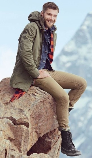 How to wear: khaki chinos, navy crew-neck t-shirt, blue denim jacket, olive parka