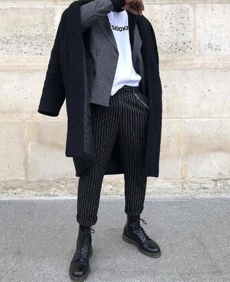 How to wear: black vertical striped dress pants, white and black print crew-neck t-shirt, grey check double breasted blazer, black overcoat