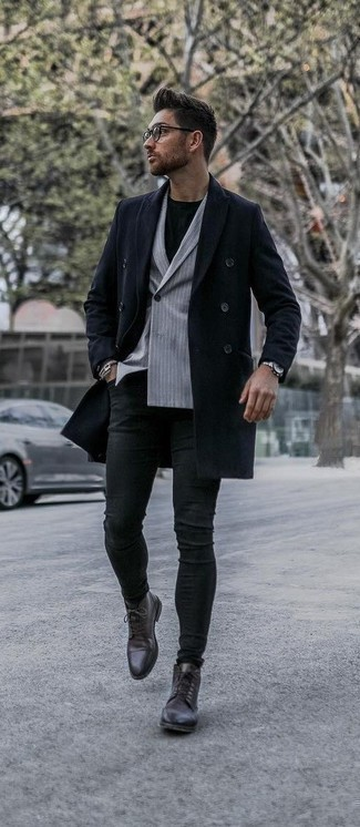 Men's Looks & Outfits: What To Wear In Chill Weather: A navy overcoat and black skinny jeans work together smoothly. To add a bit of classiness to your ensemble, complete your look with a pair of dark brown leather dress boots.