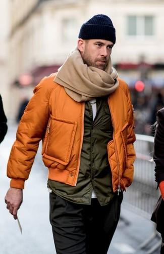 How to wear: black chinos, white crew-neck t-shirt, olive gilet, orange bomber jacket