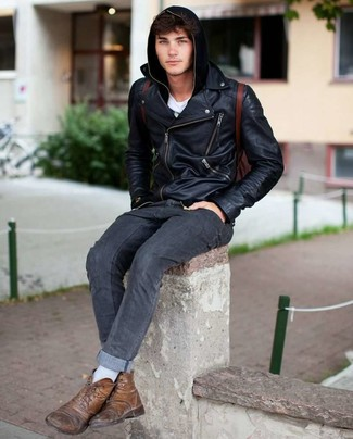 How to wear: charcoal jeans, white crew-neck t-shirt, black hoodie, black leather biker jacket