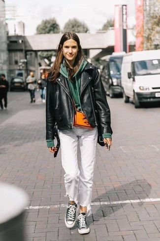 How to Wear White Jeans In Chill Weather For Women: Make a black leather biker jacket and white jeans your outfit choice for relaxed dressing with a modernized spin. Add a more casual aesthetic to this look by rounding off with a pair of black and white canvas high top sneakers.