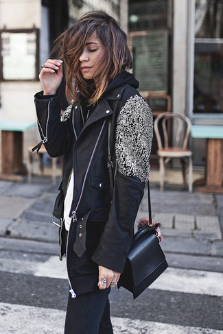 How to wear: black skinny jeans, white crew-neck t-shirt, black hoodie, black embellished leather biker jacket
