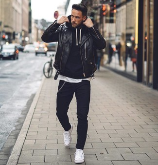 How to wear: black skinny jeans, white crew-neck t-shirt, black hoodie, black leather biker jacket