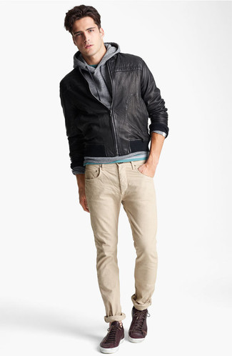 How to wear: beige jeans, green crew-neck t-shirt, grey hoodie, black leather bomber jacket