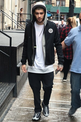 How to wear: black sweatpants, white crew-neck t-shirt, grey hoodie, black bomber jacket