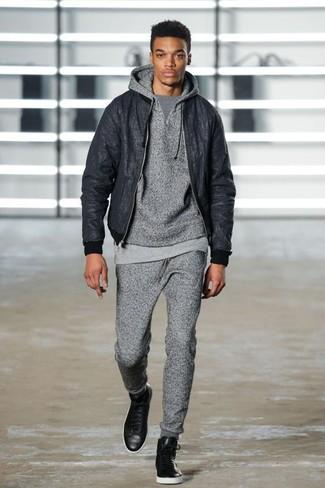 How to wear: grey sweatpants, grey crew-neck t-shirt, grey hoodie, black bomber jacket