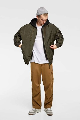 How to wear: brown cargo pants, white crew-neck t-shirt, black hoodie, olive bomber jacket