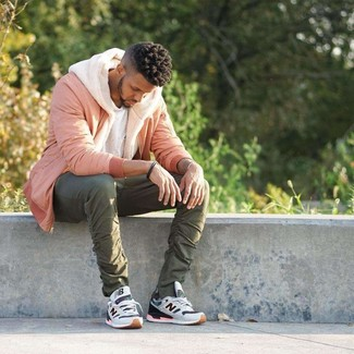 How to wear: olive chinos, white crew-neck t-shirt, beige fleece hoodie, pink bomber jacket