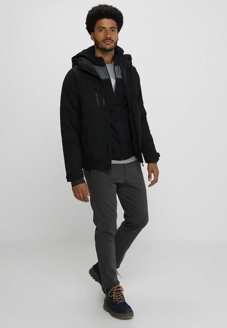 How to wear: charcoal chinos, grey crew-neck t-shirt, black hoodie, black bomber jacket
