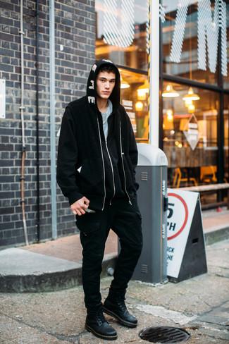 How to wear: black cargo pants, light blue crew-neck t-shirt, black and white print hoodie, black fleece bomber jacket