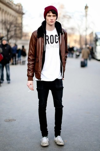 How to Wear White Canvas Low Top Sneakers For Men: The combo of a brown leather bomber jacket and black ripped skinny jeans makes this a kick-ass off-duty ensemble. Break up this ensemble by rocking white canvas low top sneakers.
