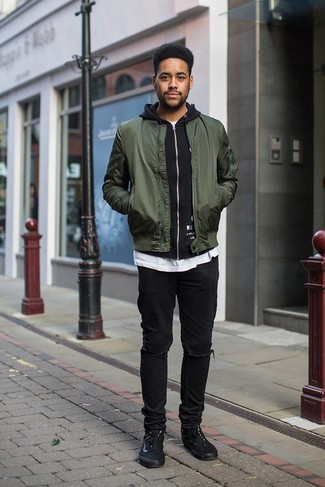 Men's Looks & Outfits: What To Wear In a Relaxed Way: Consider wearing a dark green bomber jacket and black ripped jeans to create a really dapper and current modern casual ensemble. As for the shoes, you can stick to a more elegant route with a pair of black canvas low top sneakers.