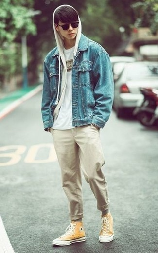 How to Wear Khaki Jeans For Men: If you don't take fashion too seriously, go for neat and relaxed style in a light blue denim jacket and khaki jeans. A pair of mustard canvas high top sneakers will add more depth to this look.