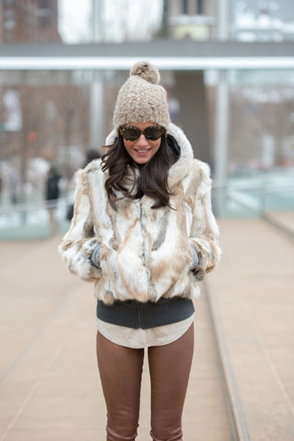 How to wear: brown leather skinny pants, beige crew-neck t-shirt, charcoal hoodie, white fur jacket