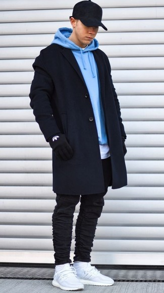 How to wear: black skinny jeans, white crew-neck t-shirt, light blue hoodie, black overcoat