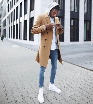 How to wear: blue skinny jeans, white crew-neck t-shirt, grey hoodie, camel overcoat