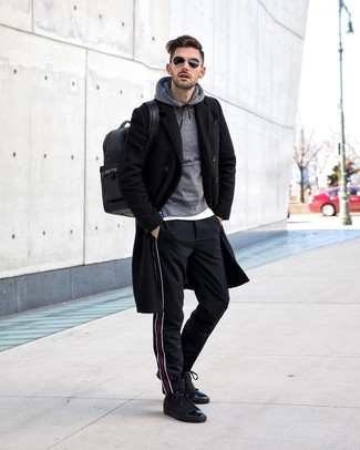 How to wear: black vertical striped chinos, white crew-neck t-shirt, grey hoodie, black overcoat