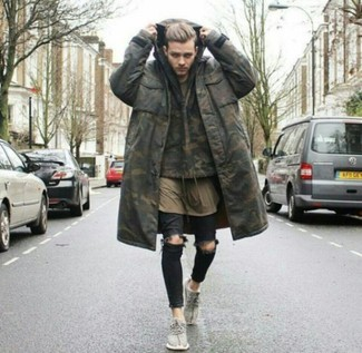 How to wear: black ripped skinny jeans, olive crew-neck t-shirt, olive camouflage hoodie, olive camouflage parka