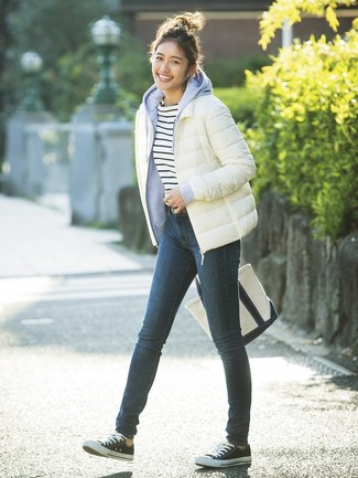 How to wear: navy skinny jeans, white and navy horizontal striped crew-neck t-shirt, light blue hoodie, white puffer jacket