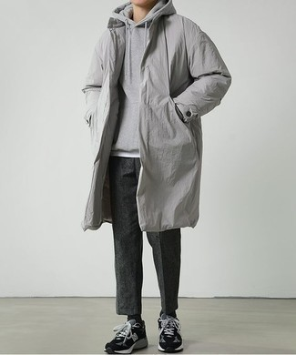 How to Wear Charcoal Wool Chinos: Flaunt your prowess in menswear styling by marrying a grey raincoat and charcoal wool chinos for a relaxed casual combo. A pair of black suede low top sneakers will pull this whole look together.