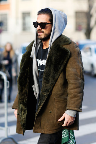 How to wear: black dress pants, black and white print crew-neck t-shirt, grey hoodie, brown shearling coat