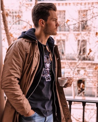 How to wear: blue jeans, black print crew-neck t-shirt, black hoodie, brown trenchcoat