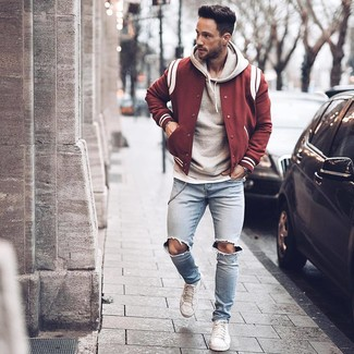 How to wear: light blue ripped skinny jeans, white crew-neck t-shirt, grey hoodie, burgundy varsity jacket