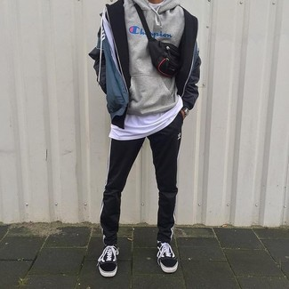 How to wear: black and white vertical striped sweatpants, white crew-neck t-shirt, grey print hoodie, navy print windbreaker