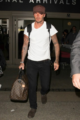 David Beckham wearing White Crew-neck T-shirt, Black Jeans, Dark Brown Suede Oxford Shoes, Black Backpack