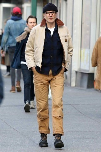 How to Wear a Beige Harrington Jacket: This off-duty combo of a beige harrington jacket and khaki chinos is very easy to throw together in seconds time, helping you look sharp and prepared for anything without spending a ton of time rummaging through your wardrobe. Go ahead and throw black leather casual boots in the mix for an extra touch of style.