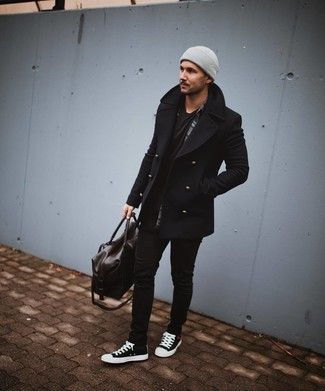 How to Wear a Dark Brown Leather Holdall For Men: For something more on the cool and casual end, you can wear a black pea coat and a dark brown leather holdall. This outfit is completed really well with a pair of black and white canvas high top sneakers.