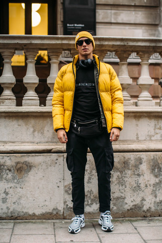 How to Wear Grey Athletic Shoes For Men: If you feel more confident wearing something comfortable, you'll love this sharp combo of a yellow puffer jacket and black cargo pants. Balance your outfit with more laid-back shoes, like these grey athletic shoes.