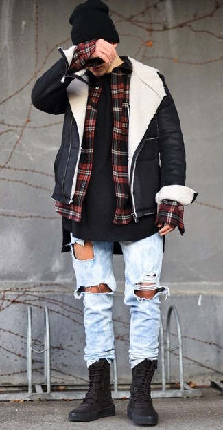 How to wear: light blue ripped jeans, black crew-neck t-shirt, red and black check flannel long sleeve shirt, black and white shearling jacket