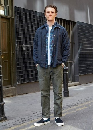 How to Wear a Navy Plaid Long Sleeve Shirt For Men: If you're scouting for a relaxed casual and at the same time seriously stylish getup, consider teaming a navy plaid long sleeve shirt with olive chinos. All you need now is a pair of navy and white canvas slip-on sneakers to complete your getup.