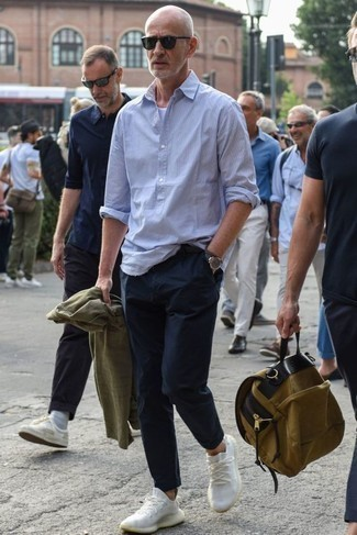 How to Wear an Olive Shirt Jacket For Men: Such staples as an olive shirt jacket and navy chinos are the ideal way to introduce some class into your off-duty fashion mix. For times when this ensemble looks too perfect, tone it down with a pair of white athletic shoes.