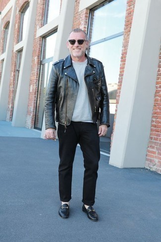 Fashion for Men Over 50: What To Wear: Go for a pared down but casually dapper look by putting together a black leather biker jacket and black chinos. In the shoe department, go for something on the smarter end of the spectrum by finishing with a pair of black leather loafers. Casual combinations for middle-aged gentlemen aren't actually that hard, as you see.