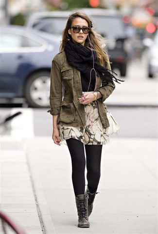 How to wear: beige print skater skirt, black crew-neck t-shirt, olive military jacket, black shawl
