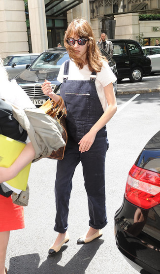 Alexa Chung wearing White Crew-neck T-shirt, Charcoal Denim Overalls, Tan Leather Ballerina Shoes, Dark Brown Print Leather Duffle Bag
