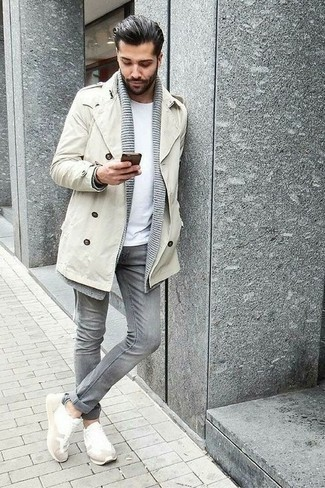 How to Wear White Athletic Shoes For Men: Rock a beige trenchcoat with grey jeans if you're going for a proper, stylish ensemble. White athletic shoes are an effective way to inject a touch of stylish casualness into this getup.