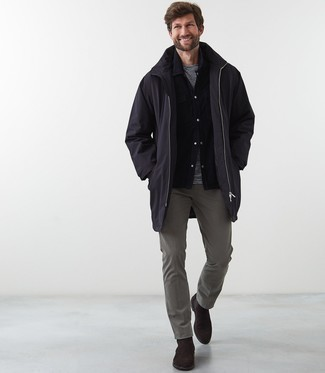 How to Wear Grey Chinos: If you're on the lookout for an off-duty yet stylish look, pair a black raincoat with grey chinos. Make your look slightly more refined by finishing with dark brown suede chelsea boots.