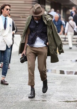 How to wear: brown chinos, white crew-neck t-shirt, navy short sleeve shirt, olive raincoat
