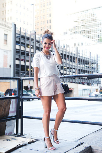 A white crew-neck t-shirt and jewelry are your go-to outfit for lazy days. Metallic leather heeled sandals will instantly smarten up even the laziest of looks. There are plenty of ways to look great and get through the super hot weather, and this here is one of them.