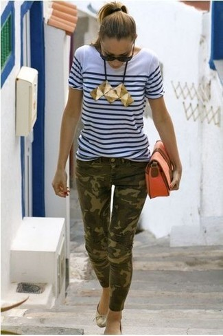 How to wear: white and navy horizontal striped crew-neck t-shirt, olive camouflage skinny jeans, gold leather ballerina shoes, orange leather clutch