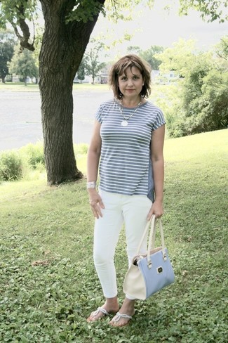 Opt for a grey horizontal striped crew-neck t-shirt and a light blue leather tote bag, if you want to dress for comfort without looking like a hobo. A pair of silver thong sandals will be a welcome addition to your ensemble. Loving how perfect this combo is come summer.