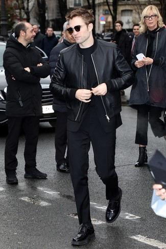 How to wear: black leather derby shoes, black crew-neck t-shirt, black suit, black leather bomber jacket