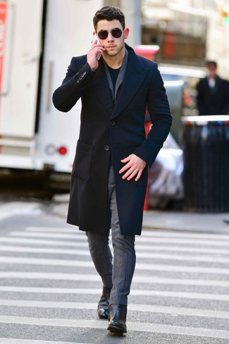 How to wear: black leather chelsea boots, black crew-neck t-shirt, grey wool suit, black overcoat