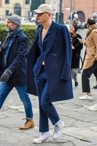 How to Wear a Blue Vertical Striped Suit: One of the smartest ways to style such a hard-working menswear item as a blue vertical striped suit is to pair it with a navy overcoat. Serve a little mix-and-match magic by slipping into a pair of white leather low top sneakers.